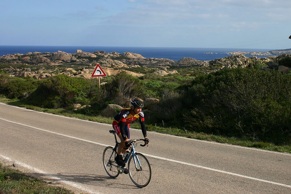Road cyclijng Sardinia: granite rocks and sea in the Gallura area