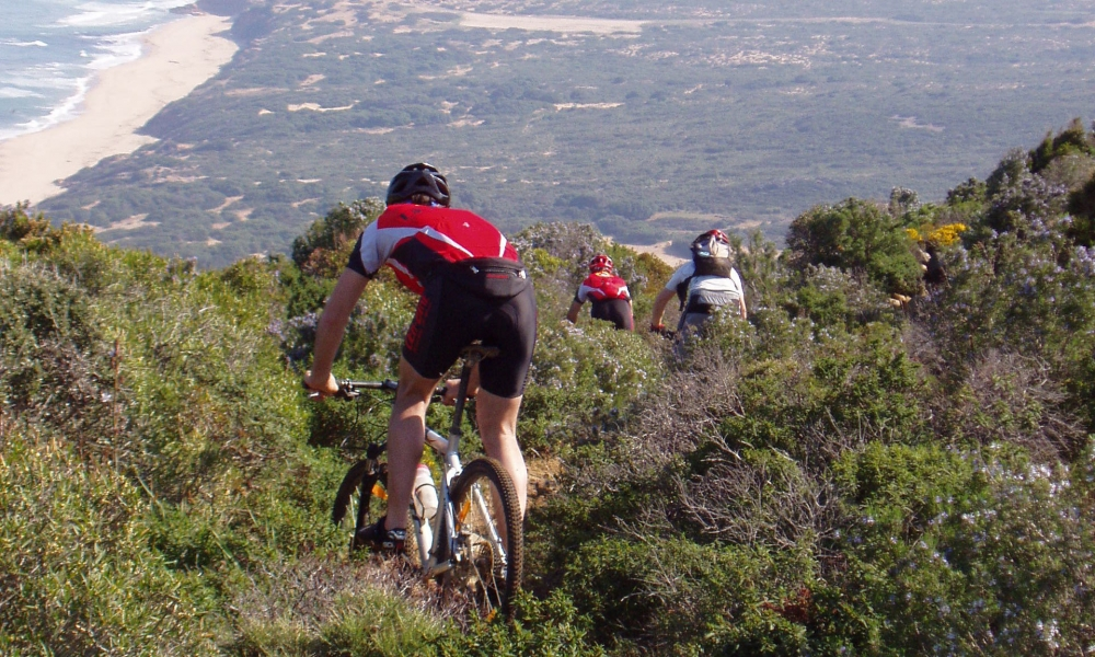 Mountain bike Sardinia: day 5, descending towards the beach of Scivu