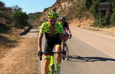 Group cycling on road bikes in Sardinia