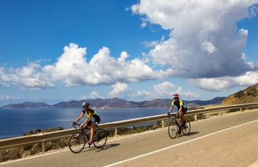 Road bike tour in Sardinia with a magic sky